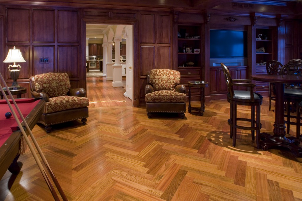 herringbone hardwood floors in billiard room