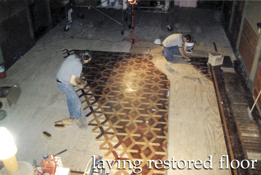 laying out restored hardwood flooring